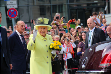 Photo of Queen Elizabeth II in 2015 during the attendance of the Berlin banquet speech. Photo Courtesy of: Wikimedia Commons by PolizeiBerlin and HalloweenNight.