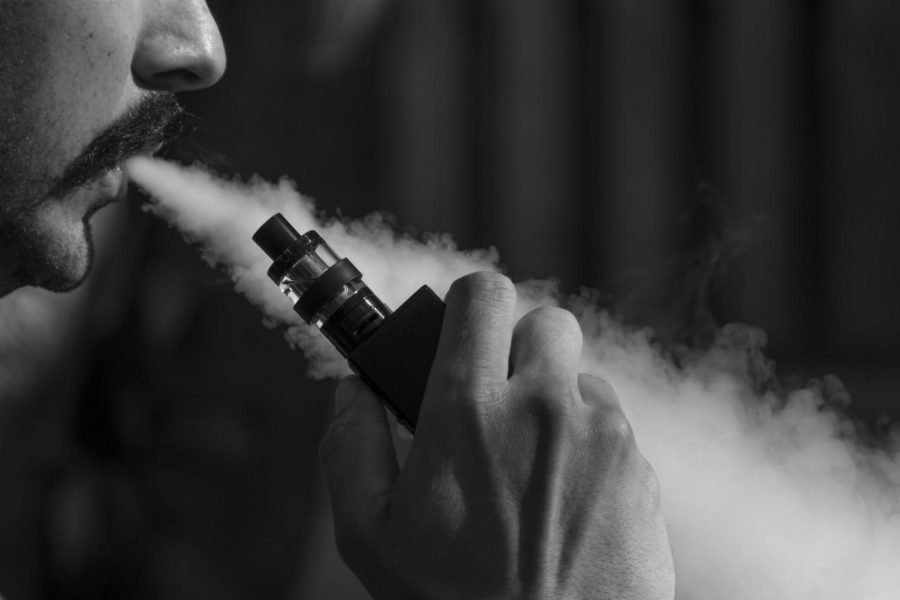 A photograph of a man and his vape. Photo Courtesy of: Pixabay