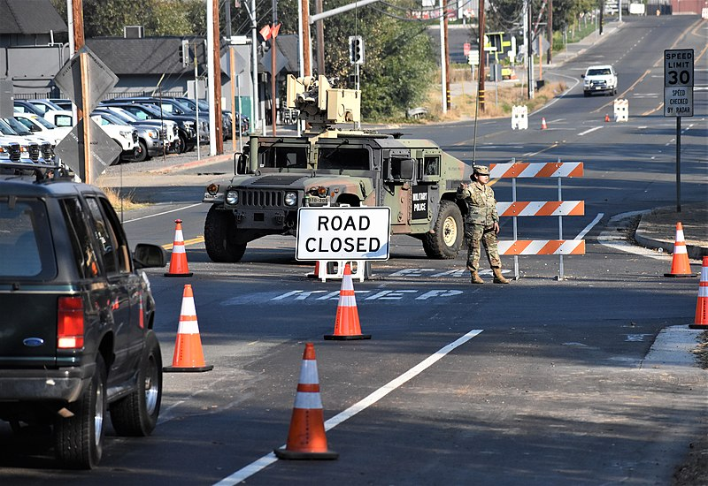 California National Guard closes down roads in Healdsburg, California. Evacuation orders were given to multiple towns nearby the Kincade Fire. Photo courtesy of: Wikimedia Commons