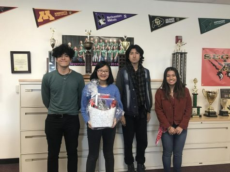 MIchelle Phan (10), Christie Vu (11), Saul Cervera (11), and Alberto Ramirez (11) stand together proudly after attending the celebratory luncheon.