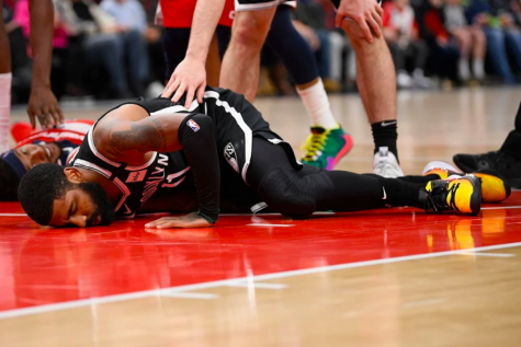 Kyrie is clearly in pain while on the Washington Wizards' floor. Photo courtesy of: NY Post