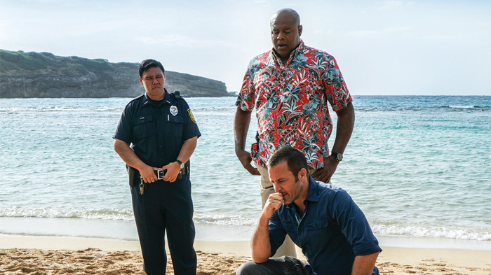 McGarrett (Alex O'Loughlin) and Grove (Chi Mcbride) investigate a murder on Oahu's beaches. Photo courtesy of: Vareity