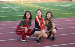 ASB Co-President Katrina Nguyen (middle) poses with junior Giovana Mondragon (left) and senior Kayla Enciso (right), wearing colorful outfits commemorating last year's Spirit Week.