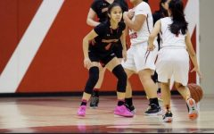Emily Ngo (#4) in her black Segerstrom Gear guarding Westminster's point guard.