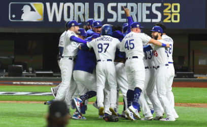 The Dodgers huddling together celebrating their win.  Photo courtesy of: The Los Angeles Times