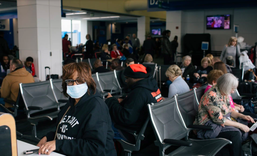 People waiting to board their flights. Photo Courtesy of: The New York Times