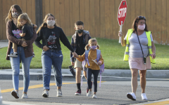 Students walk on the crosswalk to school. Photo courtesy of: LA Times