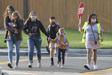 Students walk on the crosswalk to school. Photo courtesy of: LA Times