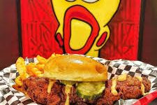 Dave's Hot Chicken slider and tender ready to be eaten up. Photo Courtesy: facebook.com