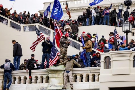 People at the Capitol waving Trump flags in support of the ex-President's claims. Also seen is a Confederate flag being held by a man in a Trump beanie. Photo courtesy of: NBC News
