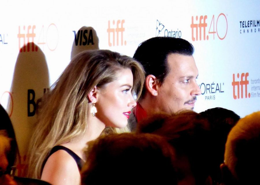 Amber Heard and Johnny Depp at the premiere of Black Mass, 2015 Toronto Film Festival. Photo courtesy of:  GabboT, CC BY-SA 2.0 , via Wikimedia Commons