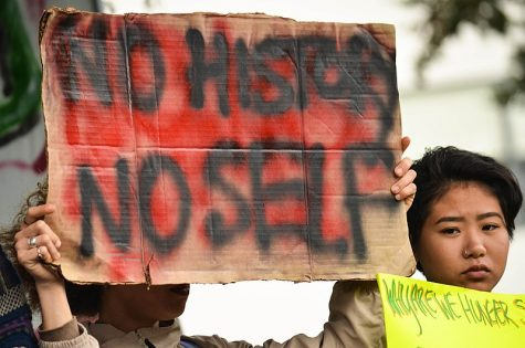 """Photo Courtesy of: Melissa Minton (Wikimedia Commons) Holding a """"No History No Self"""" sign in support as a part of the Third World Liberation Front to defend the San Francisco State College of Ethnic Studies during a press conference on May 9, 2016."""