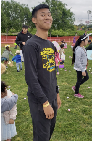 Anderson Truong smiles for the camera as he is volunteering for the Fountain Valley Easter Egg Hunt. Photo courtesy of: Anderson Truong