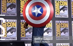 Anthony Mackie (Sam Wilson) holding a Captain America shield Photo courtesy of: Getty images
