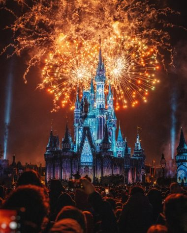 People enjoying the firework show that is surrounding the Disneyland castle. Photo Courtesy of: Zichuan Han from Pexels