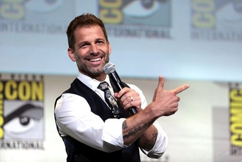 "Zack Snyder speaking at the 2016 San Diego Comic Con International, for the original ""Justice League,"" at the San Diego Convention Center in San Diego, California. Photo courtesy of: Gage Skidmore from Peoria, AZ, United States of America, CC BY-SA 2.0 , via Wikimedia Commons"