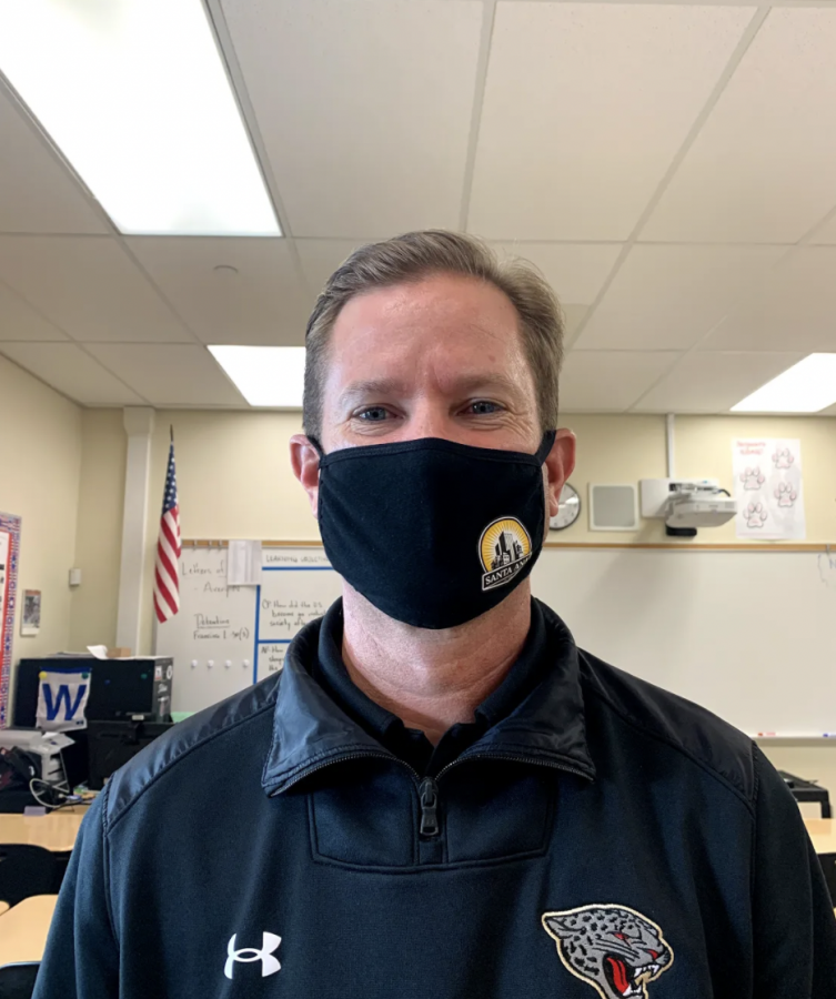 Mr. Bradshaw smiles underneath his mask after his fourth period just left for lunch. (Image courtesy of Isabella Do)