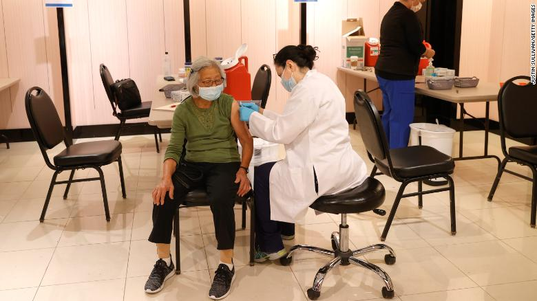 Pharmacist prepares to give her patient the Pfizer COVID-19 booster shot. (Image courtesy of CNN Health)