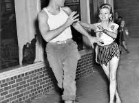 A girl chases a boy in honor of Sadie Hawkins Day. (Image courtesy of Wikipedia)