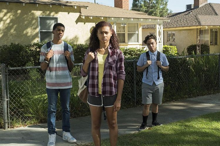 Three of the main characters, Monse Finnie, Ruby Martinez, and Jamal Turner, face in front of one of their houses. (Image courtesy of Netflix)